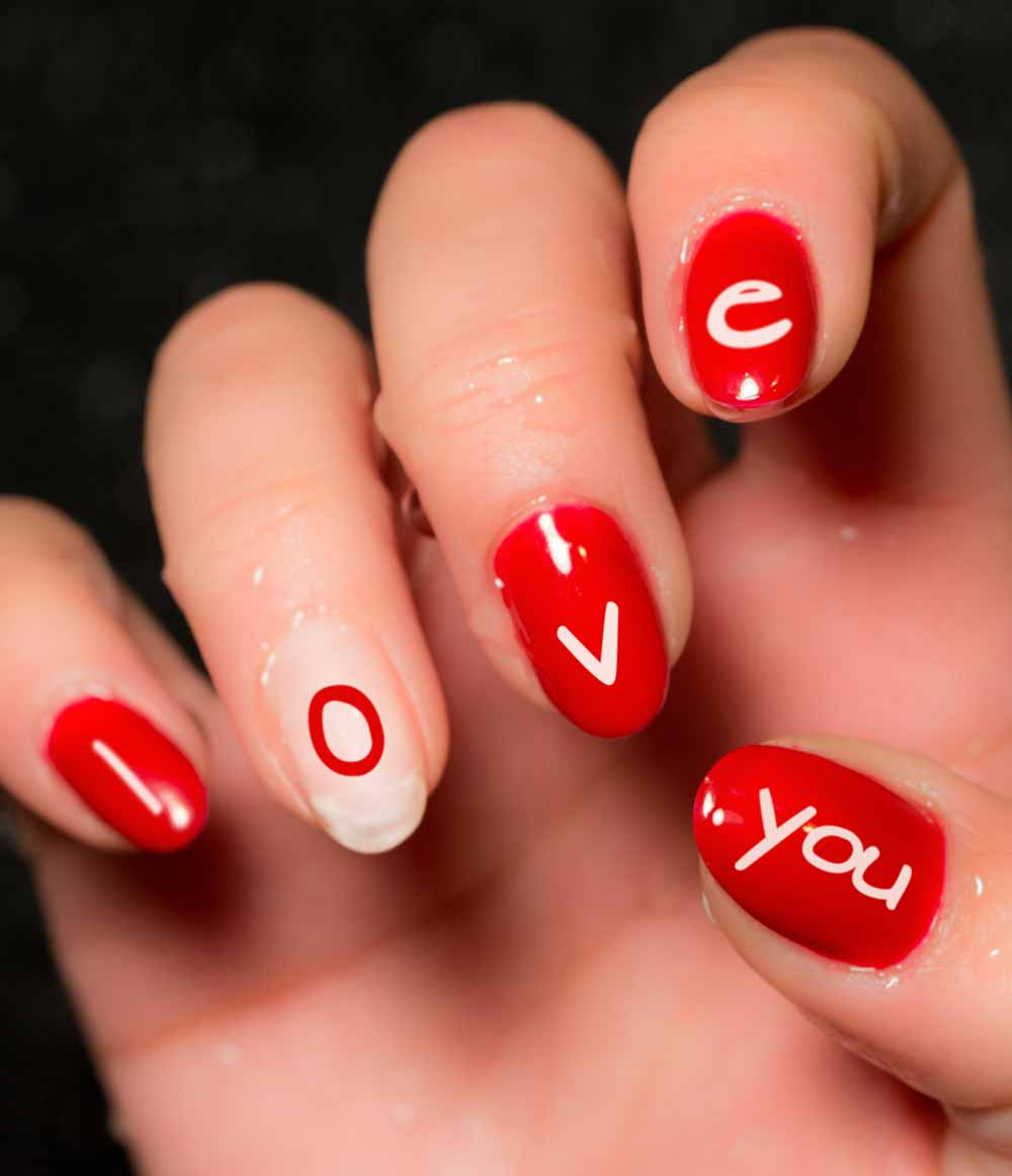 Valentine's day nail art with lettering