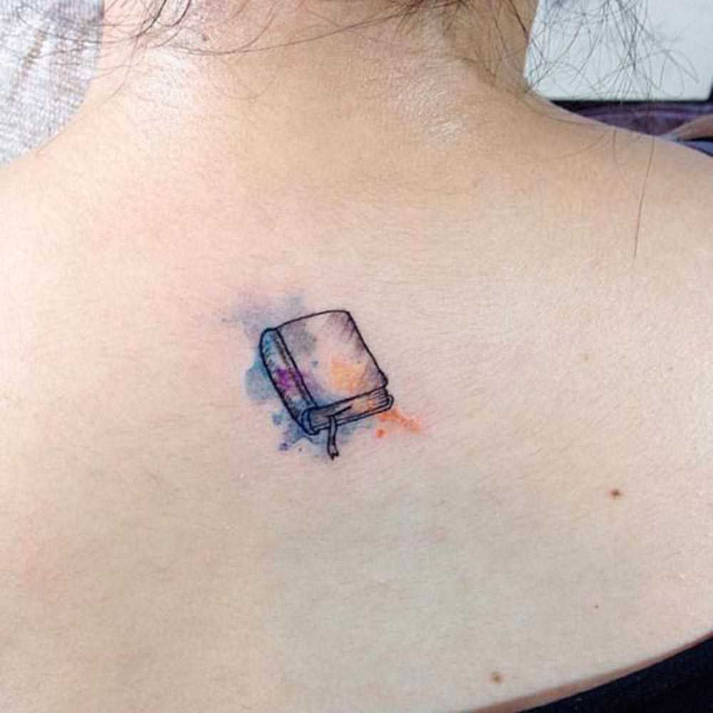 tattooed book on the neck