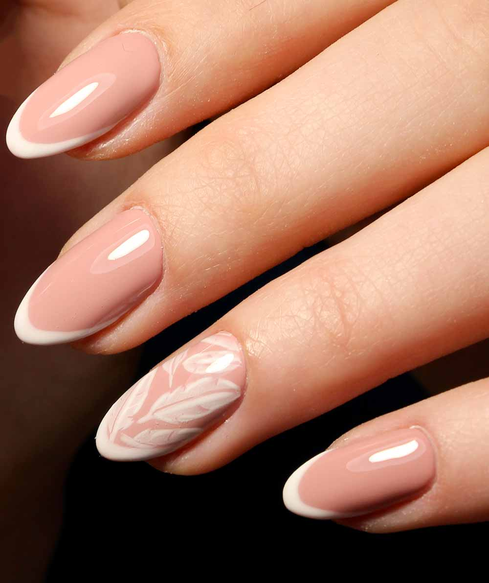 nude nail art with feather